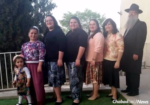 The mother of five daughters, Kotzer, second from right, instilled in them an unwavering commitment to shlichut and to helping others.