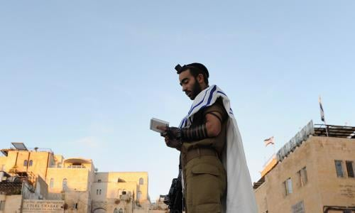 An Israeli soldier wearing tefillin in Jerusalem (Photo: Flash90/Mendy Hechtman)