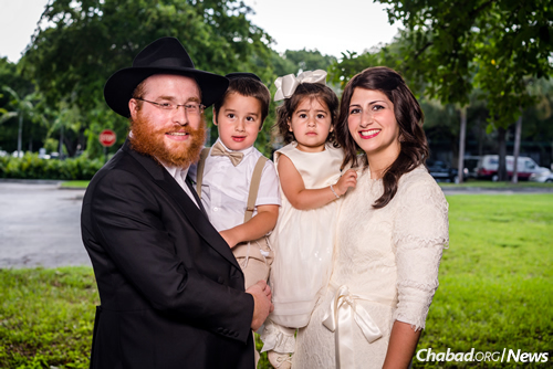 Rabbi Yossi Bendet, the day school's director of development, and Mushky Bendet, a teacher at the school, with their children