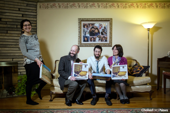 Rabbi Dovid Edelman handed out shmurah matzah in a good chunk of Massachusetts for six decades, a tradition now being carried on by his children, grandchildren and other Springfield-area rabbis. From left: granddaughter Bracha Kosofsky, son-in-law Rabbi Noach Kosofsky, grandson Rabbi Lavy Kosofsky and daughter Esther Kosofsky at their home in Longmeadow, Mass. (Photo: Pearl Gabel)