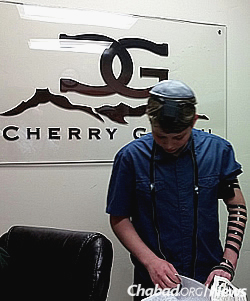 Lifshitz offers Jewish boys over the age 13 the opportunity to wrap tefillin.