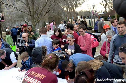 """Lining up to sign a banner that read: """"Hokies Stand Together."""""""