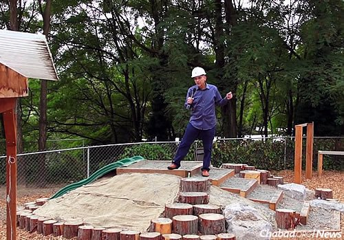 Barry Greenberg was integral to the the Campus of Jewish Life's building process and got some of his celebrity friends, including actor Elliot Gould, to help out. Here, Greenberg stands atop the natural playscape area.