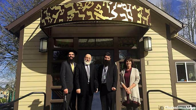 Rabbi Nochem Kaplan, second from left, chair of the National Accreditation Board of Merkos L'Inyonei Chinuch, visited Maimonides Jewish Day School and The Gan-Portland Jewish Preschool in Oregon, approving the first step for the school to earn national accreditation. From left are Rabbi Motti Wilhelm, co-director of Portland's Westside Chabad House; Rabbi Schneur Wilhelm, principal of Maimonides; and Maimonides general-studies director Shelley Sanders.
