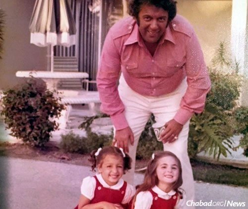 Kule and two of his three daughters in the family's early years