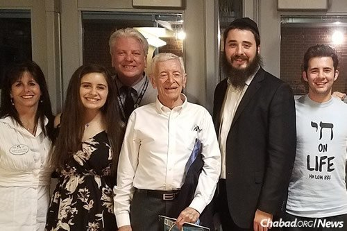 Gene Klein, a Holocaust survivor and author originally from Hungary, shared his story and his message of not standing by in the face of hate. From left are: Seminole County school board member Abby Sanchez; student Alana Halperin, also president of Club L'Chaim; teacher Dan Smith; Klein; Rabbi Mendy Bronstein, co-director of Chabad of Altamonte Springs, Fla.; and student Jordon Greenberg.