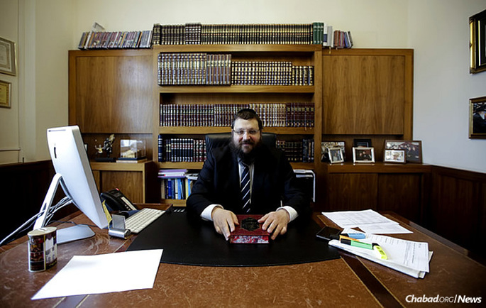 Rabbi Yehuda Teichtal sits at his desk during an interview about the construction of a new Jewish communal campus in Berlin, Germany. (AP Photo/Markus Schreiber)