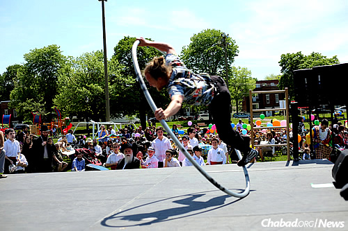 Acrobats, clowns, bounce houses, music and kosher snacks are on tap for the festivities.