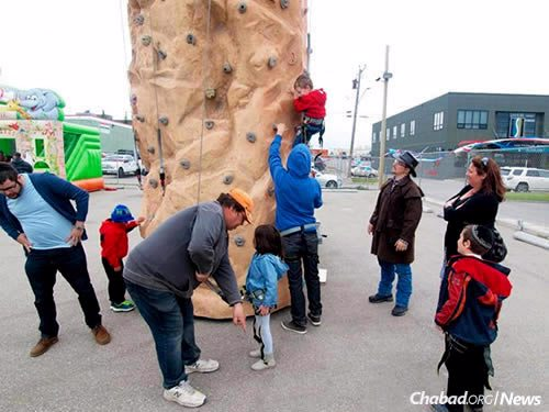 Children climbed a rock wall, played mini-golf and spent time at the petting zoo.