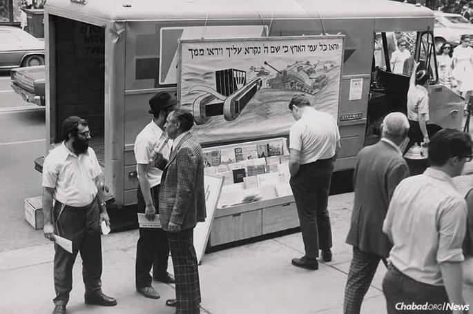 "In 1974, ""New York Times"" reporter Irving Spiegel visited 770, and the Rebbe referenced the painting on a mitzvah truck. ""Tell him these are our tanks against assimilation,"" the Rebbe told Rabbi Yehuda Krinsky. The trucks at last had a name. (Photo: Kehot Publication Society)"