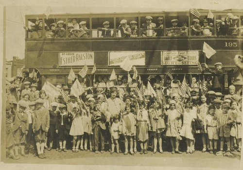 """Hebrew School children and their teachers greet the rebbe. The handwritten inscription on the back of the photo reads: """"This picture was taken on Sunday May [...] near the Shaare Zedek when the Libavitzer Rabbi came to St. Louis. We all paraded him [from] the station. R. Klayman"""". (Courtesy Dr. Hilton Price)"""