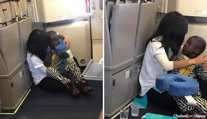 Chabad-Lubavitch emissary Rochel Groner comforts a boy with autism on a transatlantic flight from Europe to the United States.