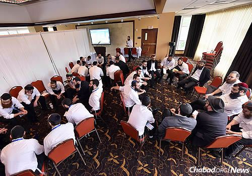 Breakout sessions for the men . . .. (Photo: Shmuel Amit)