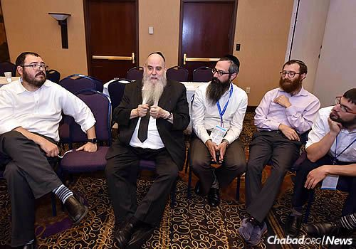 Offering support and advice is, second from left, Rabbi Moshe Kotlarsky, vice chairman of Merkos L'Inyonei Chinuch, the educational arm of Chabad. (Photo: Shmuel Amit)