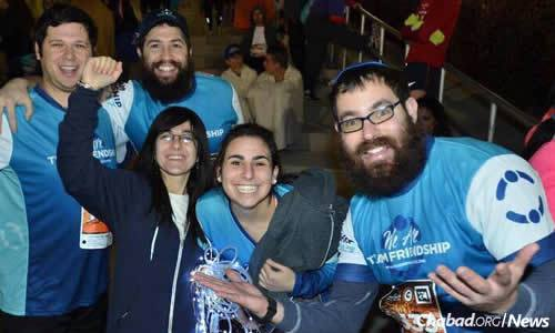 Rochel Groner, center left, and Rabbi Bentzi Groner, right, at a Friendship Circle event.