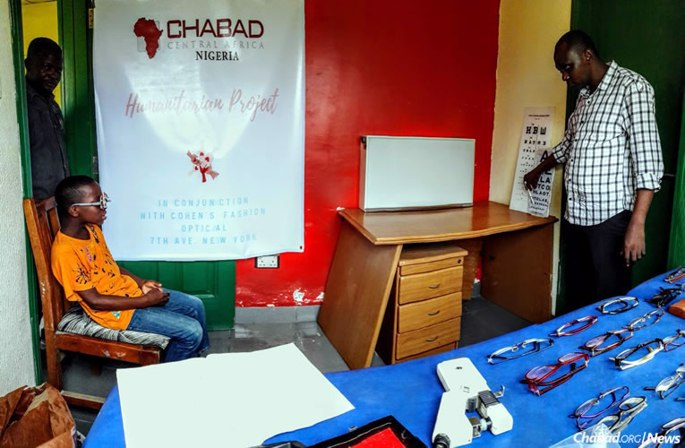 Children get their eyes tested by doctors from the College of Medicine at the University of Lagos in Nigeria. (Photo: Chabad of Nigeria)
