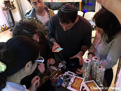 Young Jewish professionals work to figure out the clues of an escape room activity. (Photo: The Chabad Jewish Community of Korea)