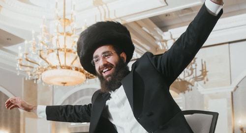Wearing a modern shtreimel at a wedding in New York.