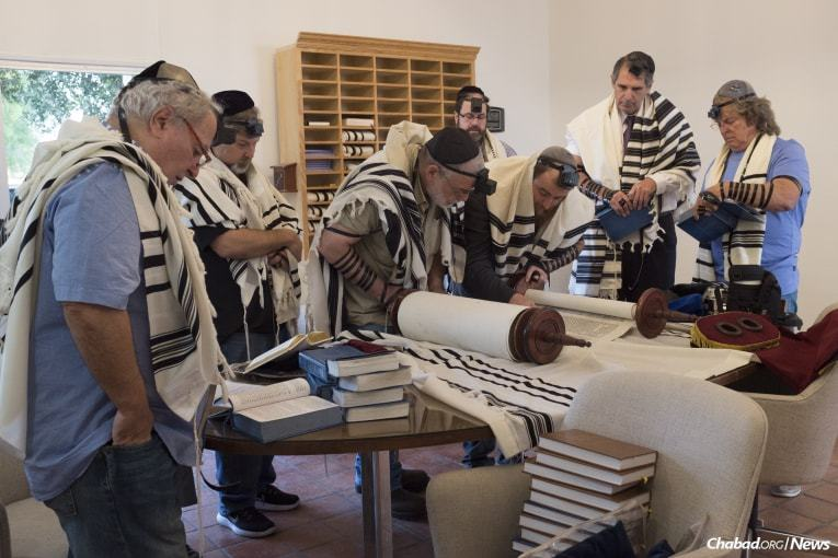Schmukler, third from right, prays with congregants at Chabad of the Rio Grande Valley in McAllen, Texas, before departing on a relief mission to Rockport, Texas. (Photo: Verónica G. Cárdenas/Chabad.org)