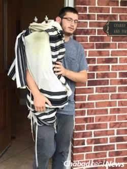 Evacuating Torah scrolls from Chabad of Sugar Land.