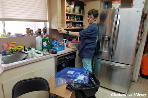 """Susy Brown, who was rescued as the floodwaters rose, says """"the volunteers have been amazing! We have kosher meals delivered, and a team of young people to work with me and my children as we salvage our home."""""""