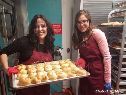 Katie Resnick and Manya Lazaroff prepare kosher baked goods to send to Houston.
