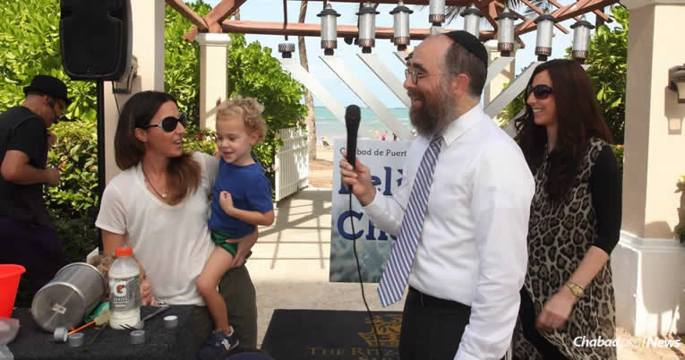 Rabbi Mendel and Rachel Zarchi, right, co-directors of Chabad Lubavitch of Puerto Rico, shown here at the opening of the Chabad center in 2016, made stops in San Juan before going to where they hoped would be safe refuge from impending Hurricane Irma. (File photo)
