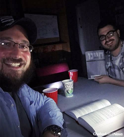 Rabbi Levik Dubov, co-director of Chabad of Downtown Orlando, studied with others by candlelight to pass the time without power.