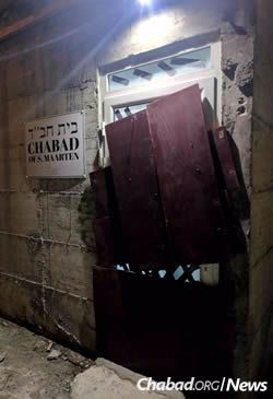 Not only did the boards on the Chabad House door pop off, the door itself eventually got blown away while the Chanowitz family waited out the storm.