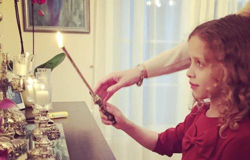Chaya Simons lighting candles.