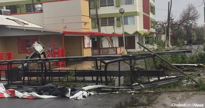 """When Rabbi Mendel Zarchi, co-director of Chabad of Puerto Rico with his wife, Rachel, stepped out after Hurricane Maria had passed, """"we were met by devastating destruction; a numbness and a daze [could] be seen over the faces of the few that ventured out at that time."""""""