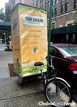 A pedi-sukkah meets neighborhood needs. (Photo: Howard Blas)