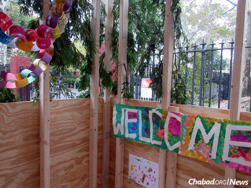 """""""Welcome"""" to the 77th Street sukkah (Photo: Howard Blas)"""