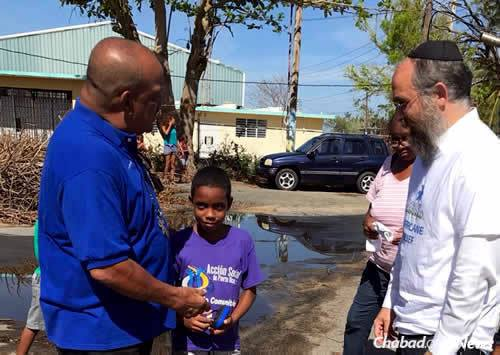 Talking with residents to assess needs; many still lack power and access to clean water.
