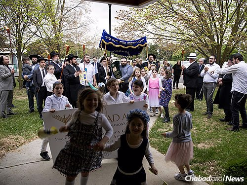 Entering the Chabad House with the new Torah (Photo: U Branding)