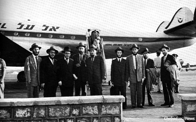 The yeshivah students (nine of the 12 seen here) chosen as the Rebbe's representatives arrived in the Lod airport on July 13, 1956, remaining in Israel for 28 days. From left: Rabbis Zushe Posner, Sholom Ber Butman, Sholom Ber Shemtov, Dovid Schochet, Yosef Rosenfeld, Sholom Eidelman, Faivel Rimler, Shlomo Kirsh and Yehuda Krinsky. (Photo courtesy of Kehot Publication Society)
