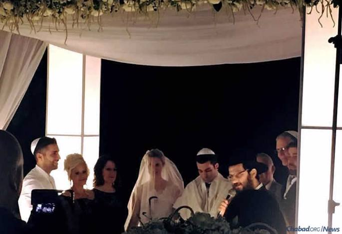 Rabbi Uriel Vigler, right, officiates at the Nov. 5 wedding of Sarah Morgan and Ido Kahlon in Hadera, Israel.