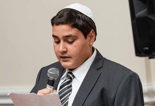 A Bar Mitzvah boy giving a speech (Serraf Studio)