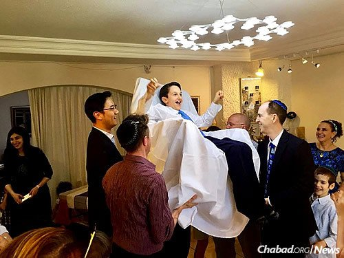The Bar Mitzvah boy is commonly picked up in a chair (Maitri Shah Photography)