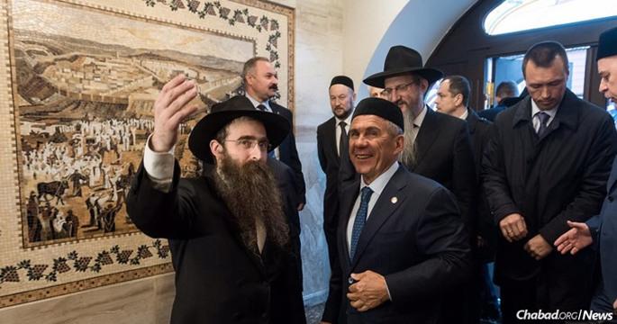 Rabbi Yitzchak Gorelik, left, shows Kazan's new yeshivah to President Rustam Minnikhanov of the Republic of Tatarstan, Russia's largest Muslim republic; Chief Rabbi of Russia Berel Lazar, center; and other visiting dignitaries.