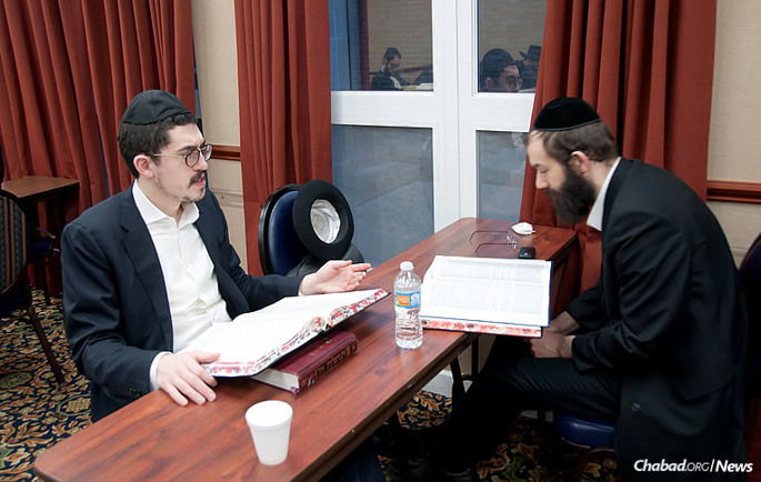 Investment advisor Akiva Goodman, left, learns with his study partner at the Bnei Ruven morning Kollel in Chicago.