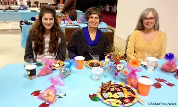 """From left: Brina Rosenberg, her mother Rhonda Rosenberg and Hazel Braitman celebrate Purim at Chabad Lubavitch of Regina, Canada. Braitman also attends the annual women's Shabbat dinner, and last year brought her 8-year-old granddaughter with her, saying """"it was a great experience . . . so much warmth and camaraderie."""""""