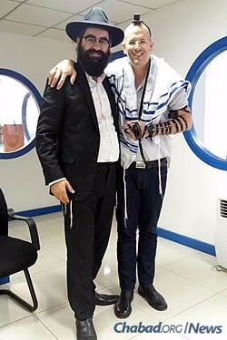 Wrapping tefillin with residents, many of them from Israel on business.