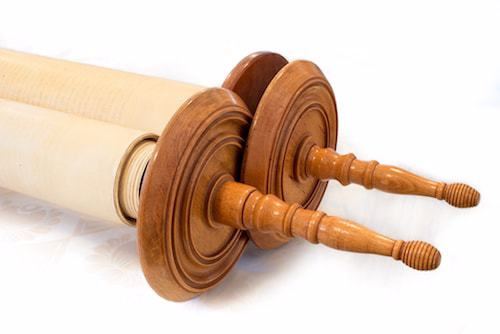 The Torah scroll is rolled around two wooden dowels.