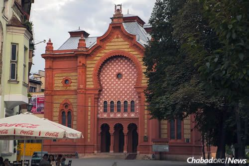 With Chanukah coming up, Wilhelm plans on again erecting a giant menorah in Uzhgorod's city center, not far from its old historic synagogue, above, now used as a philharmonic hall.