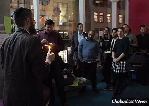 """""""We wanted to show that hidden within plain sight is the potential for a lot of light and a lot of revelation,"""" says Rabbi Mordechai Lightstone, shown leading a prior Chanukah event."""