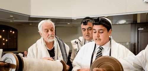 Getting an aliyah by the Torah (Credit: Serraf Studio)
