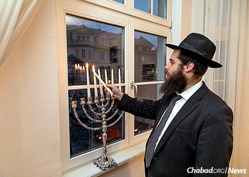 Lighting candles during the eight-day holiday of Chanukah. (Photo: Mitya Kolomiyets)