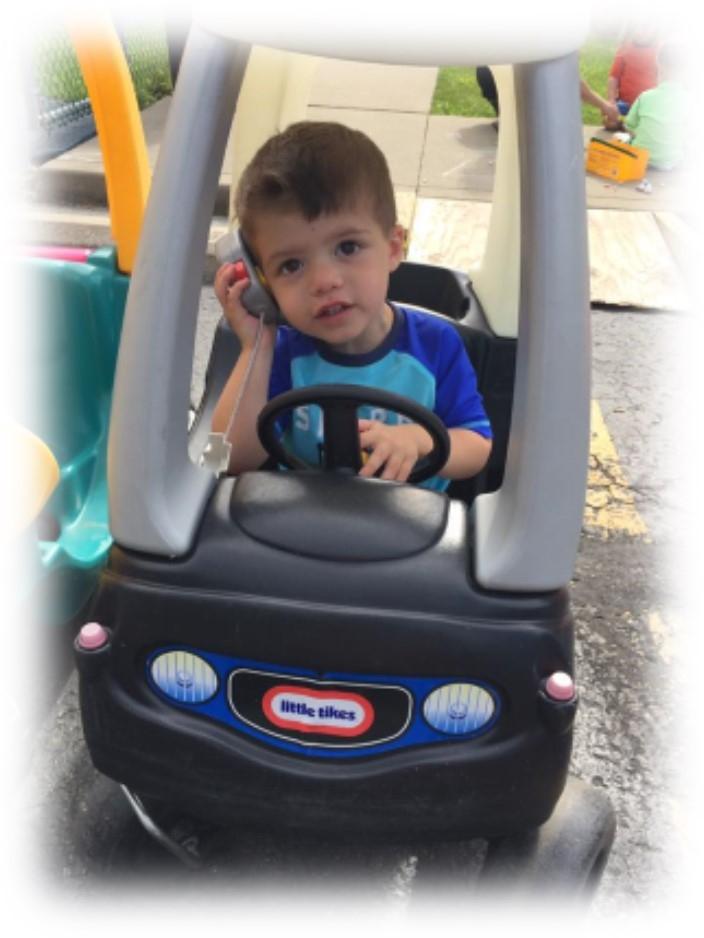 Solon Jewish Preschool Kid in car.jpg