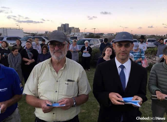 Rabbi Hillel Bernstein, right, the newly appointed rabbi of the Milnerton Hebrew Congregation who partnered in the service, stands in prayer with his father, community leader Roy Bernstein.